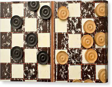 Draughts Pieces Canvas Print by Tom Gowanlock
