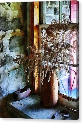Dried Flowers On Windowsill Canvas Print by Susan Savad