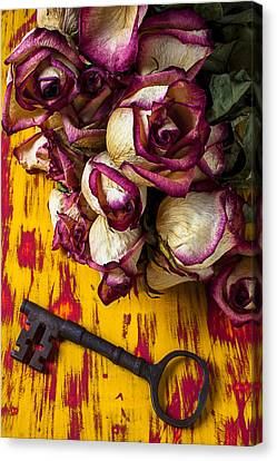 Dried Pink Roses And Key Canvas Print by Garry Gay