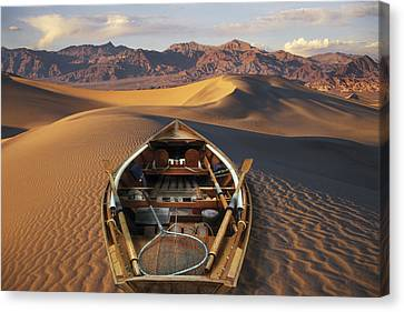 Drift Boat Resting On Sand Dunes In Canvas Print by Ron Sanford