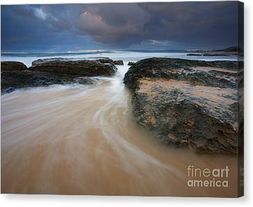 Driven Between The Rocks Canvas Print by Mike Dawson