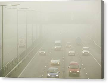 Driving In Fog On The M1 Motorway Canvas Print by Ashley Cooper