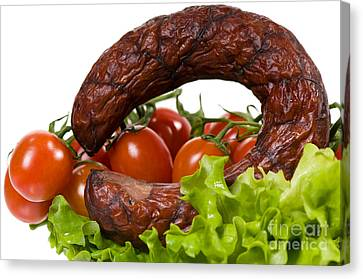 Kielbasa Canvas Print - Sausage Lying On Lettuce With Red Cherry Tomato  by Arletta Cwalina