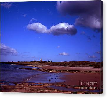 Dunstanburgh Castle From Beach At Embleton Bay Embleton Northumberland England Canvas Print by Michael Walters