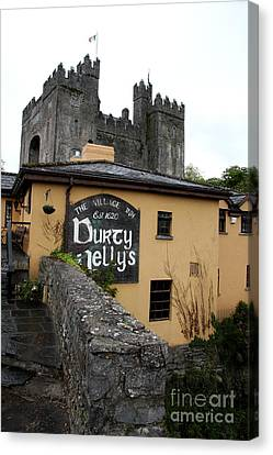 Durty Nellys And Bunraty Castle Canvas Print by Christiane Schulze Art And Photography