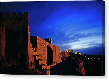 Dusk Over Bam Citadel Canvas Print by Babak Tafreshi