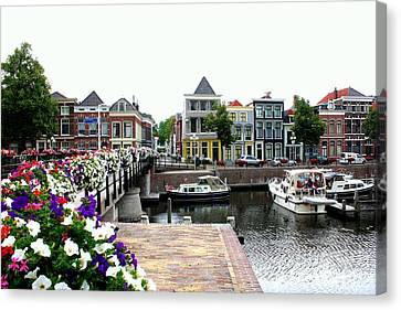 Dutch Cityscape With Boats Canvas Print by Carol Groenen