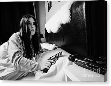 Early Twenties Woman Waking Holding Handgun In Bed In A Bedroom Canvas Print by Joe Fox