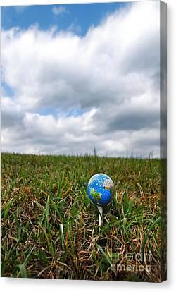 Earth Golf Ball On Tee Canvas Print by Amy Cicconi