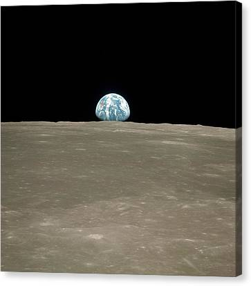Earthrise Over Moon Canvas Print by Nasa