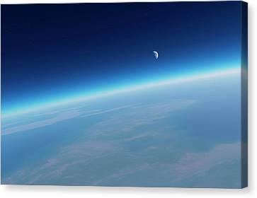 Earth's Atmosphere And Moon Canvas Print by Detlev Van Ravenswaay