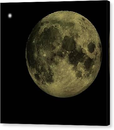 Earths Moon And Venus Canvas Print by David Dehner