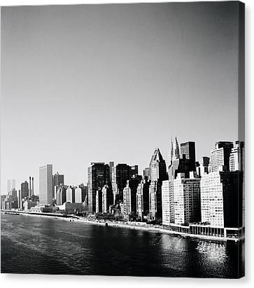 East River New York Canvas Print by Shaun Higson