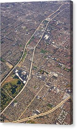 Eastern Los Angeles From The Air. Canvas Print by Mark Williamson