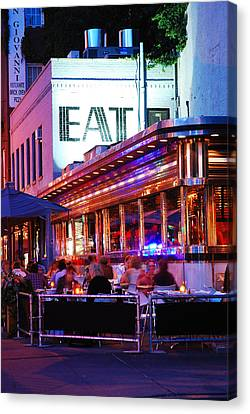 Eat Canvas Print by James Kirkikis