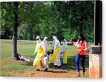 Ebola Care Training Exercise Canvas Print by Cleopatra Adedeji/cdc