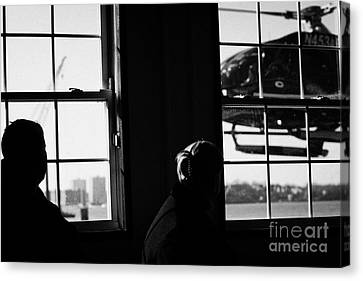 Ec130 American Eurocopter Comes In To Land Watched By Two Passengers New York Canvas Print by Joe Fox