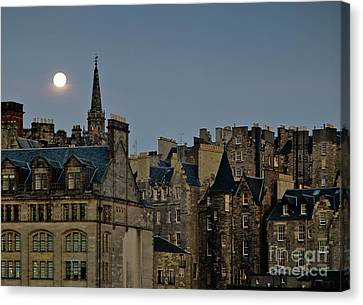 Edinburgh Old Town Skyline From Princes Street With The Spire Of Tron Kirk Dusk Evening Full Moon Canvas Print by David Lyons