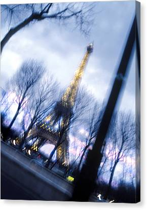 Eiffel On The Move Canvas Print by Mike McGlothlen