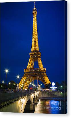 Eiffel Tower By Night Canvas Print by Inge Johnsson