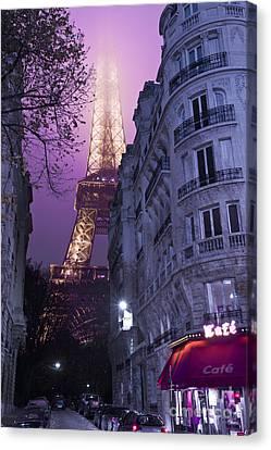 Eiffel Tower From A Side Street Canvas Print by Simon Kayne