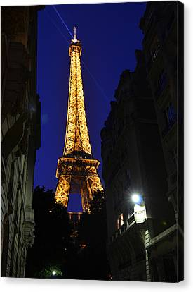 Eiffel Tower Paris France At Night Canvas Print by Patricia Awapara