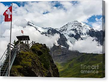 Eiger And Monk In The Clouds - Swiss Alps Canvas Print by Gary Whitton