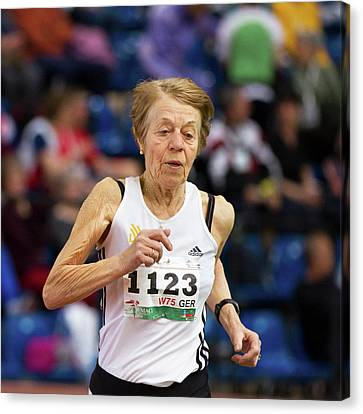 Elderly Female Athlete In Competition Canvas Print by Alex Rotas