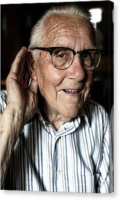 Elderly Man With Hearing Loss Canvas Print by Mauro Fermariello