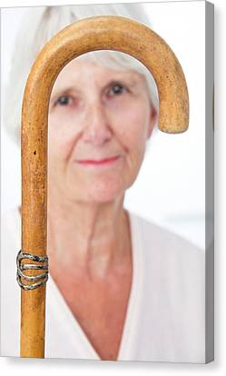 Elderly Woman And Walking Stick Canvas Print by Lea Paterson