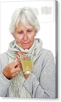 Elderly Woman Drinking Hot Lemon Canvas Print