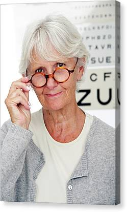 Elderly Woman Wearing Glasses Canvas Print by Lea Paterson