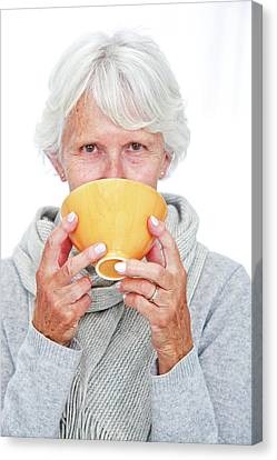 Elderly Woman With A Hot Drink Canvas Print