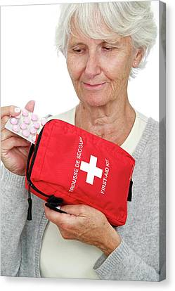 Elderly Woman With First Aid Kit Canvas Print by Lea Paterson