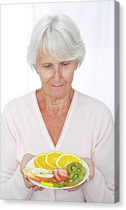 Elderly Woman With Fruit Canvas Print by Lea Paterson