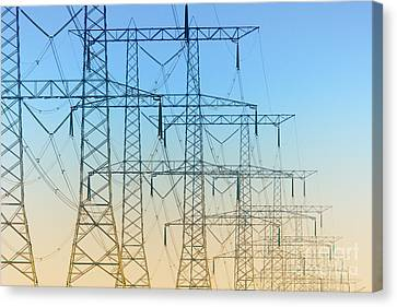Electricity Pylons Standing In A Row Canvas Print