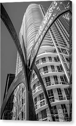 Statue Portrait Canvas Print - Element Of Duenos Do Los Estrellas Statue With Miami Downtown In Background - Black And White by Ian Monk