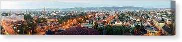 Romania Canvas Print - Elevated View Of A City Lit Up At Dusk by Panoramic Images