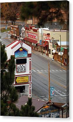 Elevated View Of Buildings Along Street Canvas Print by Panoramic Images