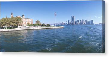 Ellis Island, Manhattan Skyline, New Canvas Print by Panoramic Images