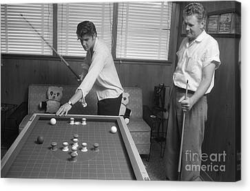 Elvis Presley And Vernon Playing Bumper Pool 1956 Canvas Print by The Harrington Collection