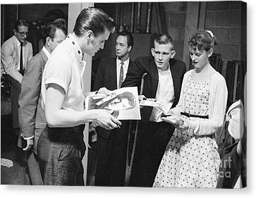 Elvis Presley Backstage Signing Autographs For Fans 1956 Canvas Print by The Harrington Collection