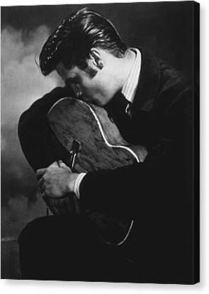 Hall Of Fame Canvas Print - Elvis Presley Kisses Guitar by Retro Images Archive