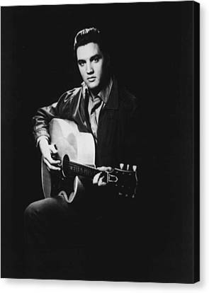 Elvis Presley Playing Guitar Canvas Print by Retro Images Archive