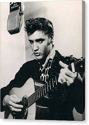 Elvis Presley Plays And Sings Into Old Microphone Canvas Print by Retro Images Archive