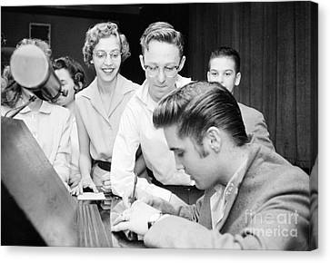 Elvis Presley Signing Autographs For Fans 1956 Canvas Print by The Harrington Collection