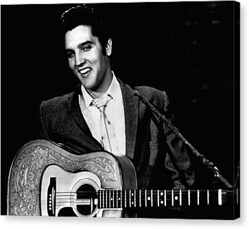 Elvis Presley Smiles While Holding Guitar Canvas Print by Retro Images Archive