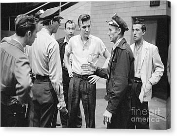 Elvis Presley Speaking With Police Officers In 1956 Canvas Print by The Harrington Collection