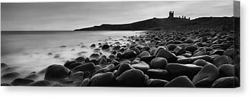 Embleton Bay With Dunstanburgh Castle Canvas Print by Ian Cumming