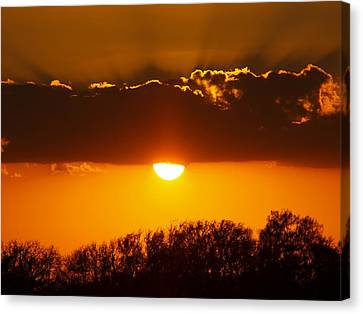 Emergence Of A Golden Sun Canvas Print by James Granberry